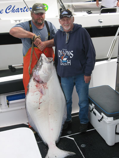 Jim Aitchison . .from zero to HERO . . about 135 lbs of halibut glory