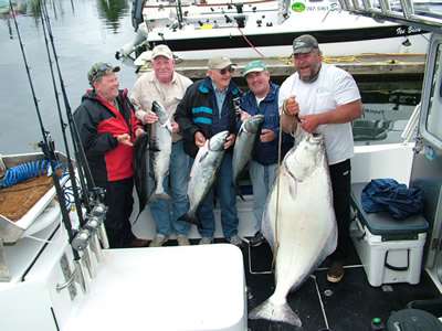 Ronnie Fields caught this big 136 lb Halibut . . . smiling all the way