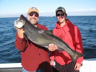 Jacob and dad fishing with Big Blue Charters, Alaska
